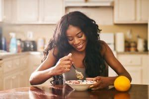 woman enjoys healthy breakfast